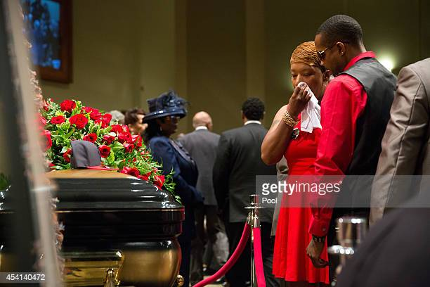 Lesley McSpadden stands at the casket during the funeral services for her son Michael Brown inside Friendly Temple Missionary Baptist Church on...