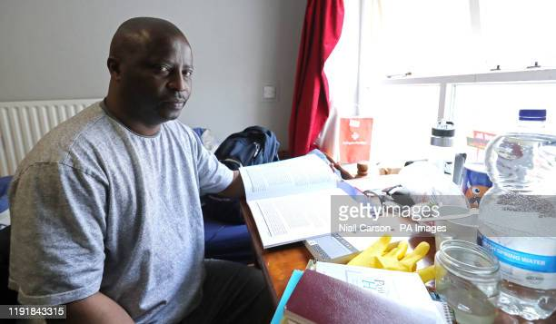 Lesley Mkoko who fled Swaziland three years ago studies in his Direct Provision room that he shares with two other men at Viking House in Waterford.