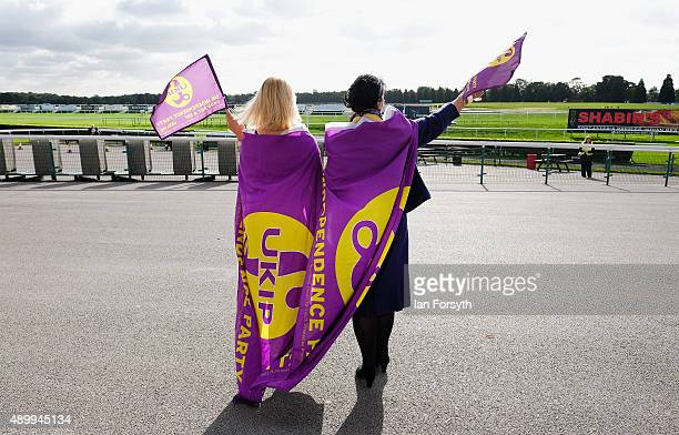 Lesley Nicholls and Betty Dearden wear and wave UKIP flags at Doncaster Racecourse during the UK Independence Party annual conference on September 25...