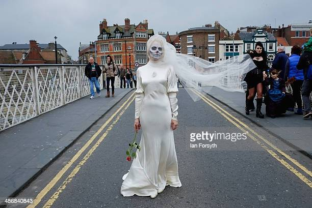 Lesley Scaife from Harrogate wears a wedding dress and painted face during the Goth weekend on April 26 2014 in Whitby England The Whitby Goth...