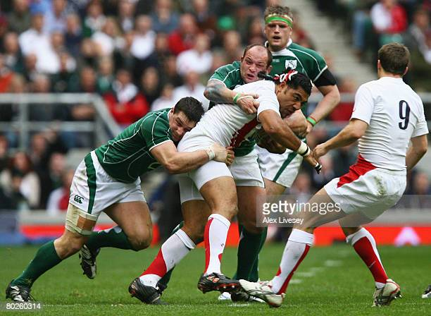 Lesley Vainikolo of England is tackled by Rory Best of Ireland and David Wallace of Ireland during the RBS 6 Nations Championship match between...