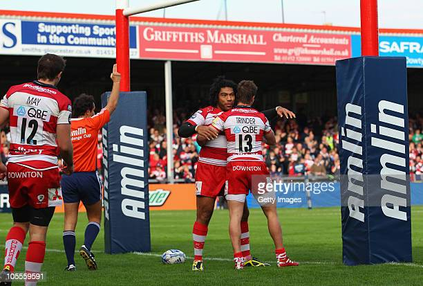 Lesley Vainikolo of Gloucester celebrates with Henry Trinder after scoring a try during the Amlin Challenge Cup match between Gloucester and Femi CZ...