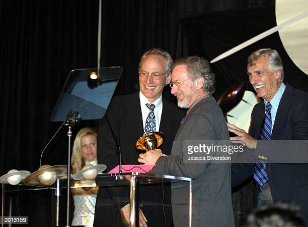 Leslie Bohem director Steven Spielberg and Dennis Weaver attend the 29th Annual Saturn Awards presented by Cinescape May 18 2003 at the Renaissance...