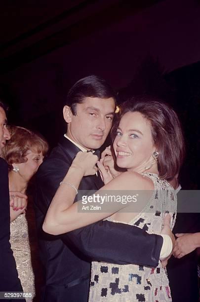 Leslie Caron dancing with Robert Evans; circa 1970; New York.