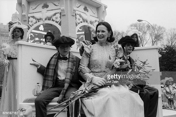 Leslie Caron in vintage costume riding on a float circa 1980 New York