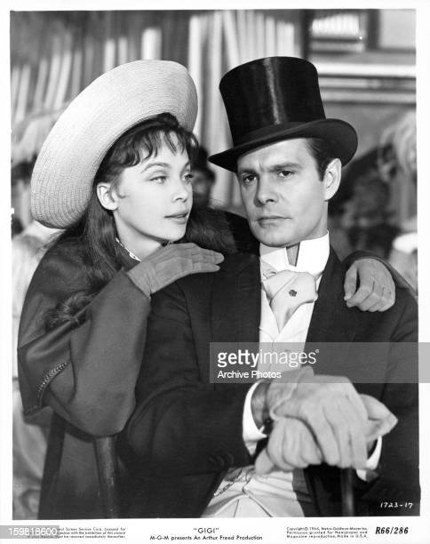 Leslie Caron leaning over the shoulder of Louis Jourdan in a scene from the film 'Gigi' 1958