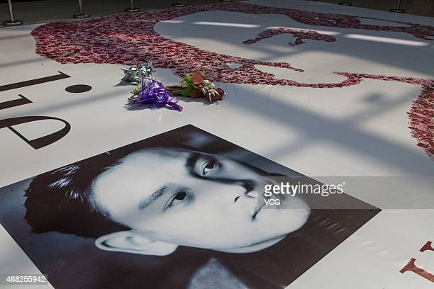 Leslie Cheung's portrait made of tens of thousands of fingerprints is seen on a canvas at Wanda Plaza on April 1 2015 in Changchun Jilin province of...