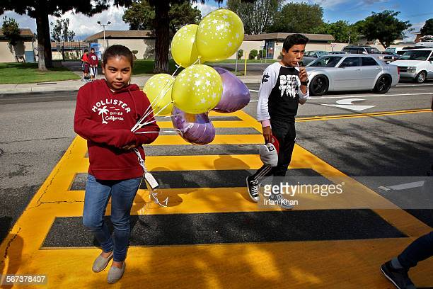 ANA CA NOVEMBER 01 2014 Leslie Corrales center along with her cousin brings balloons at a makeshift memorial where three 13yearold girls two of whom...