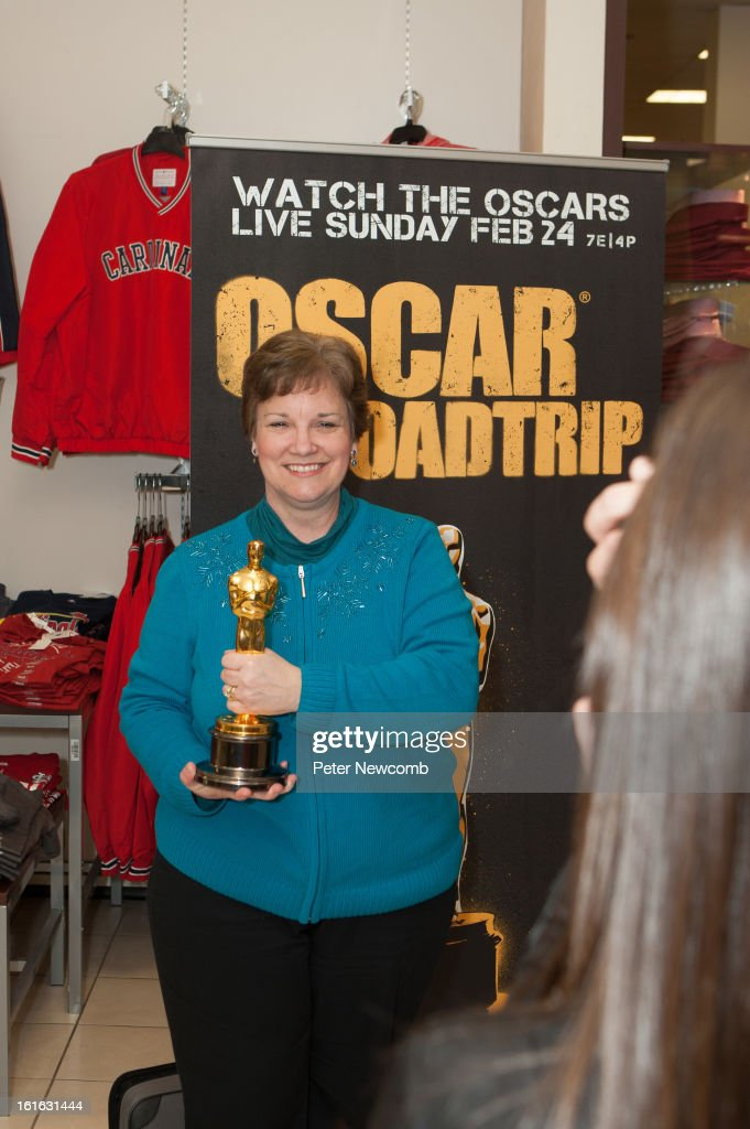 Leslie Fitzpatrick poses with Oscar in the JCP at West County Mall attends first-ever Oscar Roadtrip at on February 13, 2013 in St Louis City.