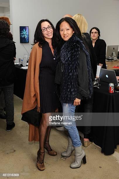Leslie Fram and Julie Miyoshi attend The Rema Hort Mann Foundation LA Artist Initiative Benefit Auction on November 21 2013 in Los Angeles California