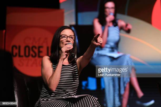 Leslie Fram takes questions from the audience when interviewing Sara Evans on the CMA Close Up Stage during the 2018 CMA Music festival at the on...