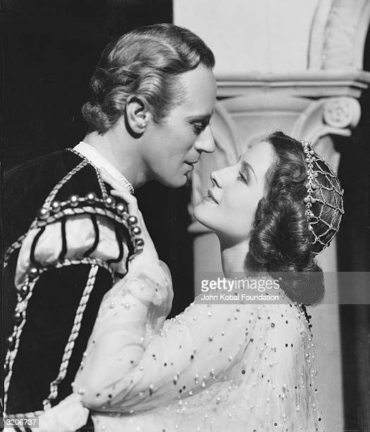 Leslie Howard and Norma Shearer starring as doomed lovers Romeo and Juliet in a romantic scene from George Cukor's adaptation of the Shakespeare play