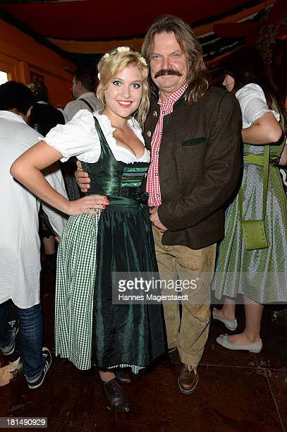 Leslie Mandoki and his daughter Lara attend the Oktoberfest beer festival at Theresienwiese on September 21 2013 in Munich Germany