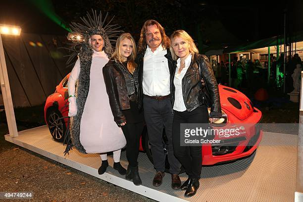 Leslie Mandoki and his wife Eva Mandoki and his daughter Julia Mandoki next to a VW beetle car during the 'Tabaluga - Es lebe die Freundschaft'...