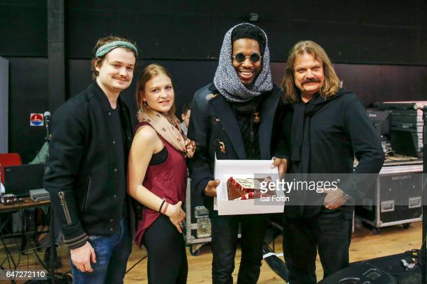 Leslie Mandoki with his kids Julia Mandoki and Gabor Mandokis and US organist composer and Gospel star Cory Henry with his birthday cake during the...