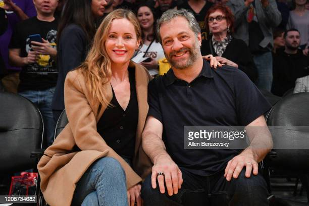 Leslie Mann and Judd Apatow attend a basketball game between the Los Angeles Lakers and the New Orleans Pelicans at Staples Center on February 25...