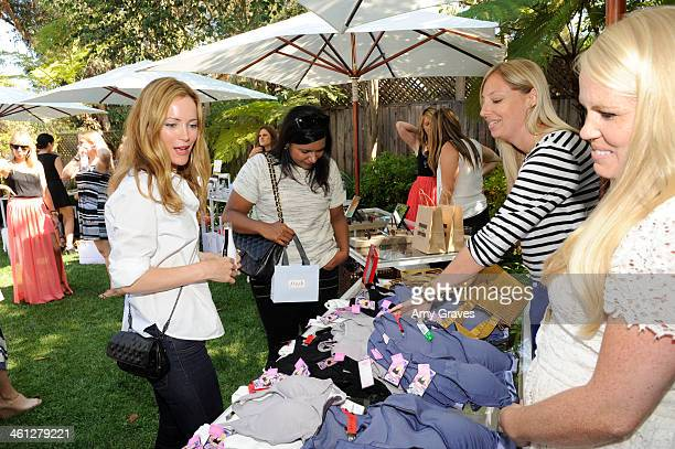 Leslie Mann and Mindy Kaling attend the annual Jen Klein Day of Indulgence Summer Party August 11 2013 in Los Angeles California