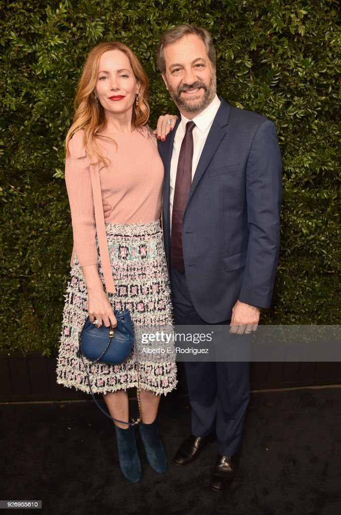 Leslie Mann, wearing CHANEL, (L) and Judd Apatow attend Charles Finch and Chanel Pre-Oscar Awards Dinner at Madeo in Beverly Hills on March 3, 2018 in Beverly Hills, California.