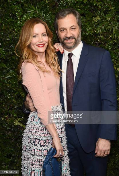 Leslie Mann wearing CHANEL and Judd Apatow attend Charles Finch and Chanel PreOscar Awards Dinner at Madeo in Beverly Hills on March 3 2018 in...
