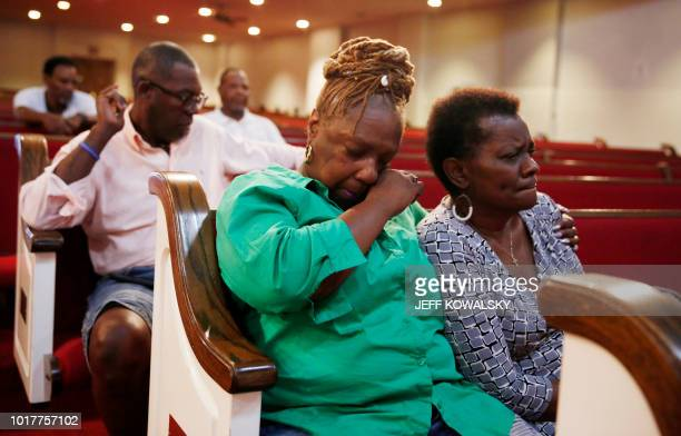 Leslie Mathews and Emma Lockridge reflect in the chapel of New Bethel Baptist Church after it was announced Aretha Franklin had passed away on August...
