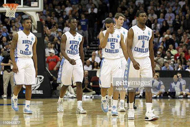 Leslie McDonald Harrison Barnes Kendall Marshall Tyler Zeller and Dexter Strickland of the North Carolina Tar Heels walks of the court after being...