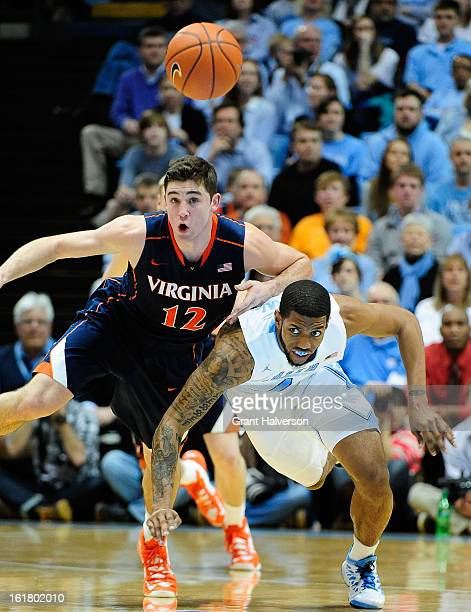 Leslie McDonald of the North Carolina Tar Heels battles for a loose ball with Joe Harris of the Virginia Cavaliers during play at the Dean Smith...