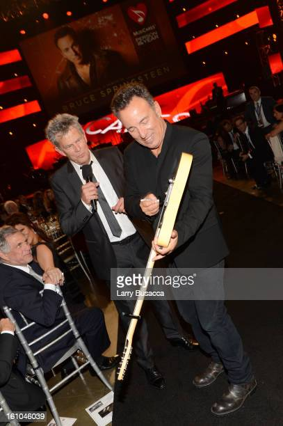 Leslie Moonves, President and Chief Executive Officer of CBS Corporation, producer David Foster and honoree Bruce Springsteen attend MusiCares Person...