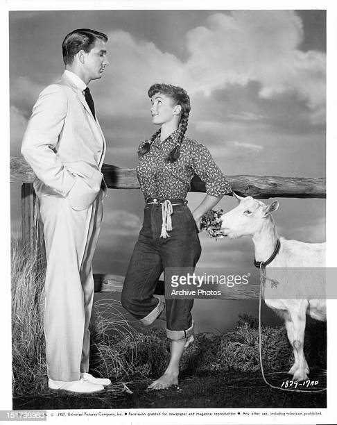 Leslie Nielsen and Debbie Reynolds with a goat in a scene from the film 'Tammy And The Bachelor' 1957