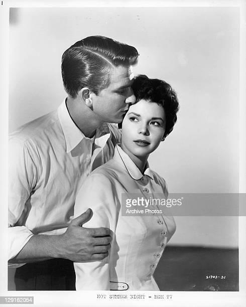 Leslie Nielsen holding Colleen Miller in a scene from the film 'Hot Summer Night' 1957