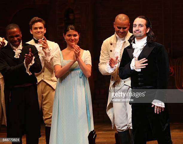 Leslie Odom Jr and Phillipa Soo with LinManuel Miranda and cast during their final performance curtain call of 'Hamilton' on Broadway at Richard...