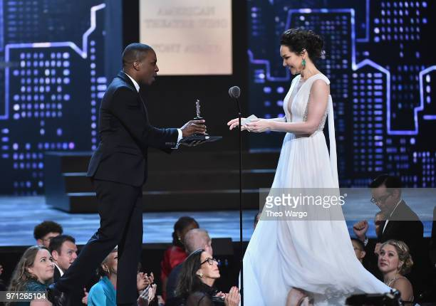 Leslie Odom Jr presents Katrina Lenk the award for Best Performance by an Actress in a Leading Role in a Musical for The Band's Visit onstage during...