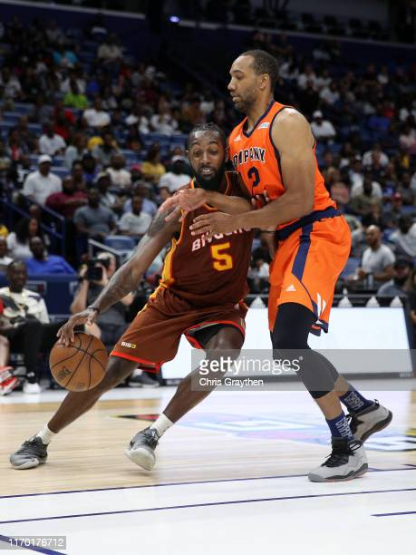 Leslie of Bivouac dribbles the ball past Andre Emmett of 3's Company during the BIG3 Playoffs at Smoothie King Center on August 25, 2019 in New...