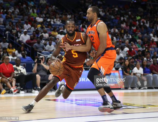 Leslie of Bivouac dribbles the ball past Dijon Thompson of 3's Company during the BIG3 Playoffs at Smoothie King Center on August 25, 2019 in New...