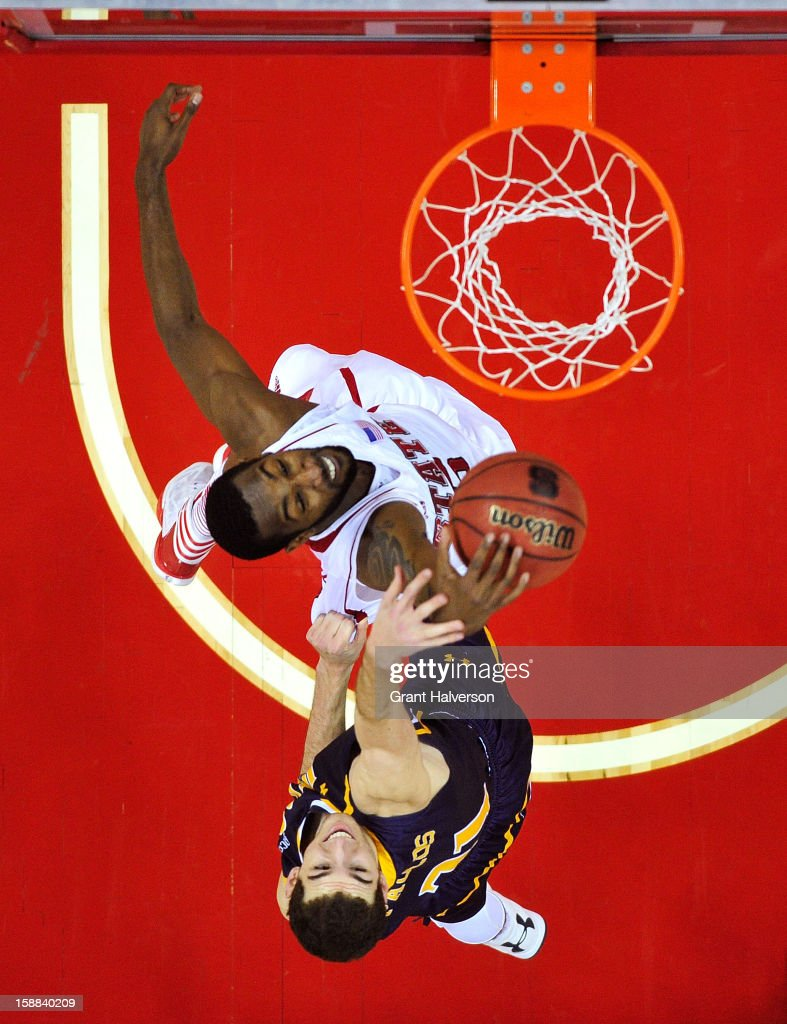 C.J. Leslie #5 of the North Carolina State Wolfpack battles for a rebound against Nicholas Paulos #31 of the UNC Greensboro Spartans during play at PNC Arena on December 31, 2012 in Raleigh, North Carolina. North Carolina State won 89-68.