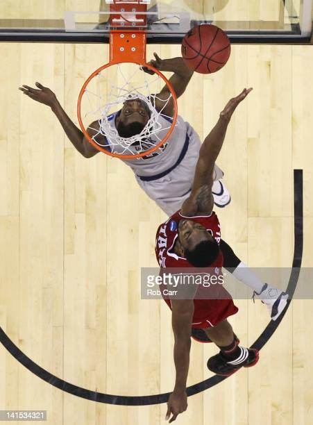 J Leslie of the North Carolina State Wolfpack blocks a shot by Jason Clark of the Georgetown Hoyas during the third round of the 2012 NCAA Men's...