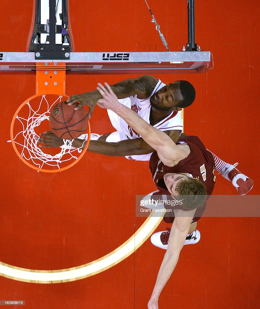 C.J. Leslie #5 of the North Carolina State Wolfpack dunks over Eddie Odio #4 of the Boston College Eagles during play at PNC Arena on February 27, 2013 in Raleigh, North Carolina. North Carolina State won 82-64.