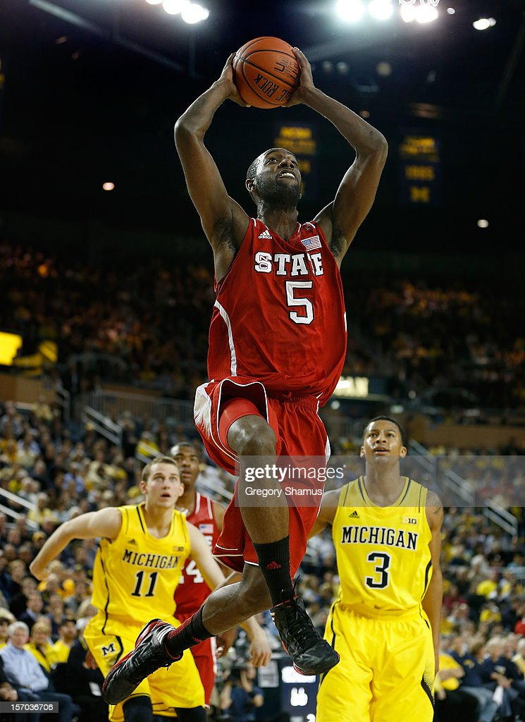 C.J. Leslie #5 of the North Carolina State Wolfpack gets in for a second half dunk past Trey Burke #3 of the Michigan Wolverines at Crisler Center on November 27, 2012 in Ann Arbor, Michigan. Michigan won the game 79-72.