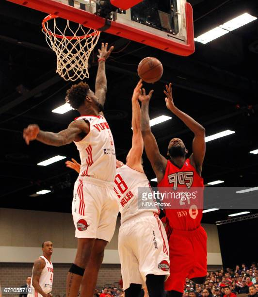 CJ Leslie of the Raptors 905 has his shot blocked by Kyle Wiltjer of the Rio Grande Valley Vipers as Chris Walker backs him up during the first game...