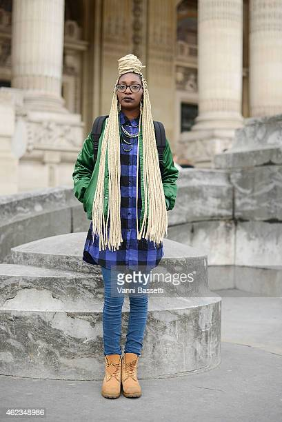 Leslie Okombi poses wearing a vintage outfit during day 3 of Paris Haute Couture Spring Summer 2015 on January 27 2015 in Paris France