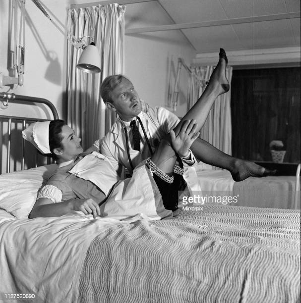 Leslie Phillips and Shirley Anne Field on the set of 'Doctor in Clover' being shot on location at Wrexham Park Hospital Slough 27th September 1965