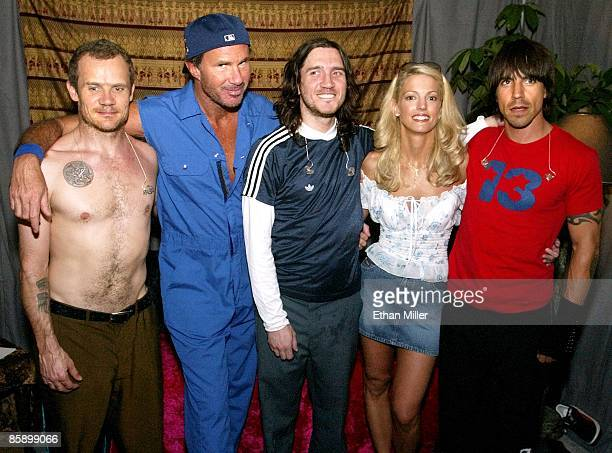 Leslie Prekop of Nevada poses with the rock band Red Hot Chili Peppers bassist Flea drummer Chad Smith guitarist John Frusciante and singer Anthony...