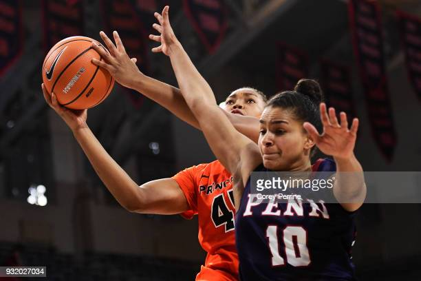 Leslie Robinson of the Princeton Tigers drives to the basket against Anna Ross of the Pennsylvania Quakers during the first quarter at The Palestra...