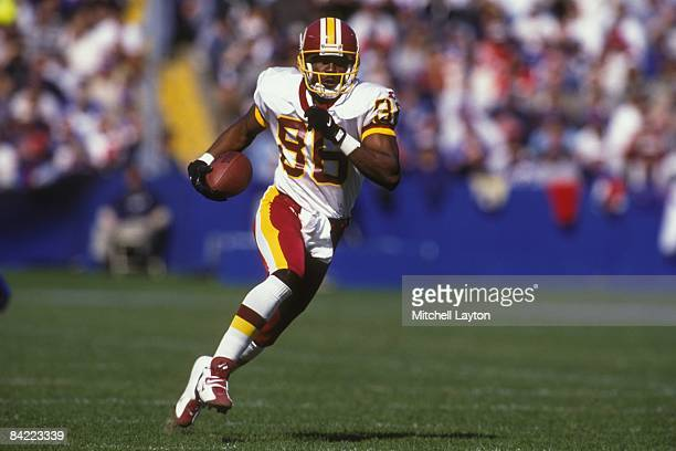 Leslie Sheppard of the Washington Redskins runs with the ball during a NFL football game against the New England Patriots on October 13 1996 at...