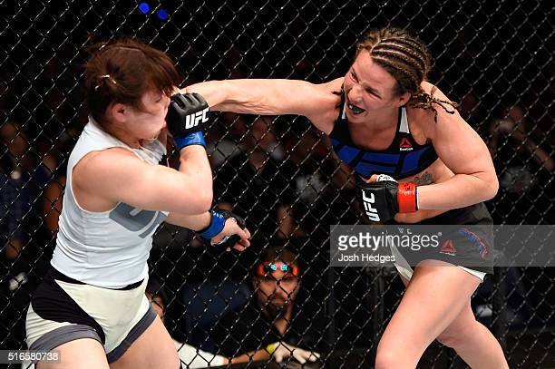 Leslie Smith of the United States punches Rin Nakai of Japan in their women's bantamweight bout during the UFC Fight Night event at the Brisbane...