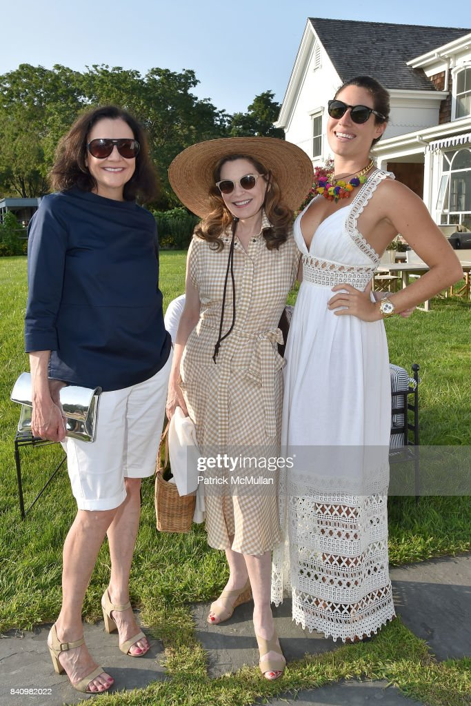 Leslie Stevens, Cathy Graham and Laura de Gunzburg attend Anne Hearst McInerney and Jay McInerney's celebration of Amanda Hearst and Hassan Pierre's Maison de Mode at a Private Residence on August 26, 2017 in Water Mill, New York.