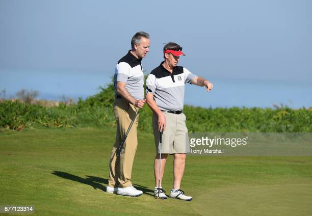 Leslie Walker of Dundalk Golf Club points out the line to Mickey Colburn Captain of Dundalk Golf Club on the 7th green during Day One of the...