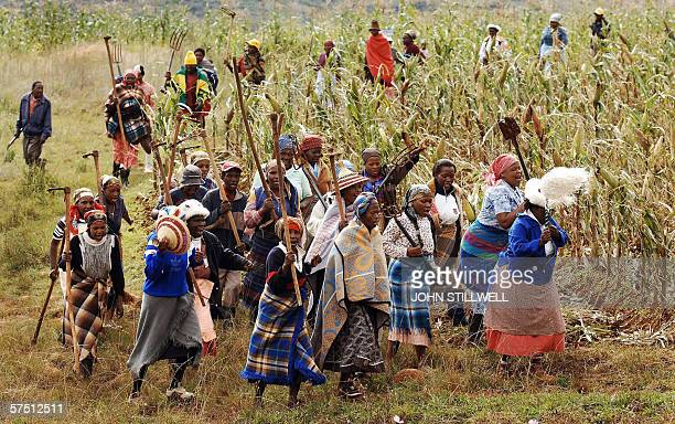 A group of singing women greet Prince Harry during a visit to the village of Phororong high in the Northern Mountains while on a return visit to...