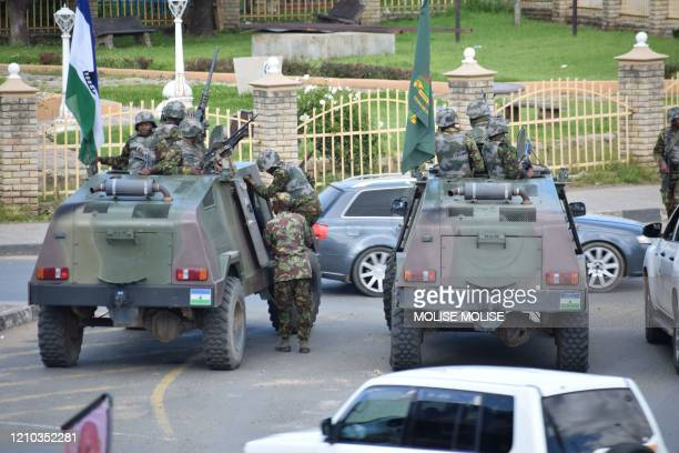 Lesotho Defense Force are seen stationed in a street in Maseru on April 18 2020 Lesotho's embattled prime minister Tom Thabane announced on Saturday...