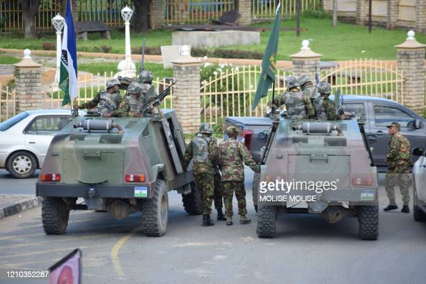 Lesotho Defense Force are seen stationed in a street in Maseru on April 18, 2020. - Lesotho's embattled prime minister Tom Thabane announced on...