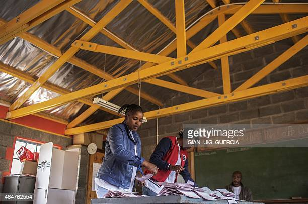 Lesotho Independent Electoral Commission marshalls start the counting process at the end of the voting process of the Lesotho parliamentary elections...